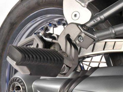 Passenger footrest lowering – titanium